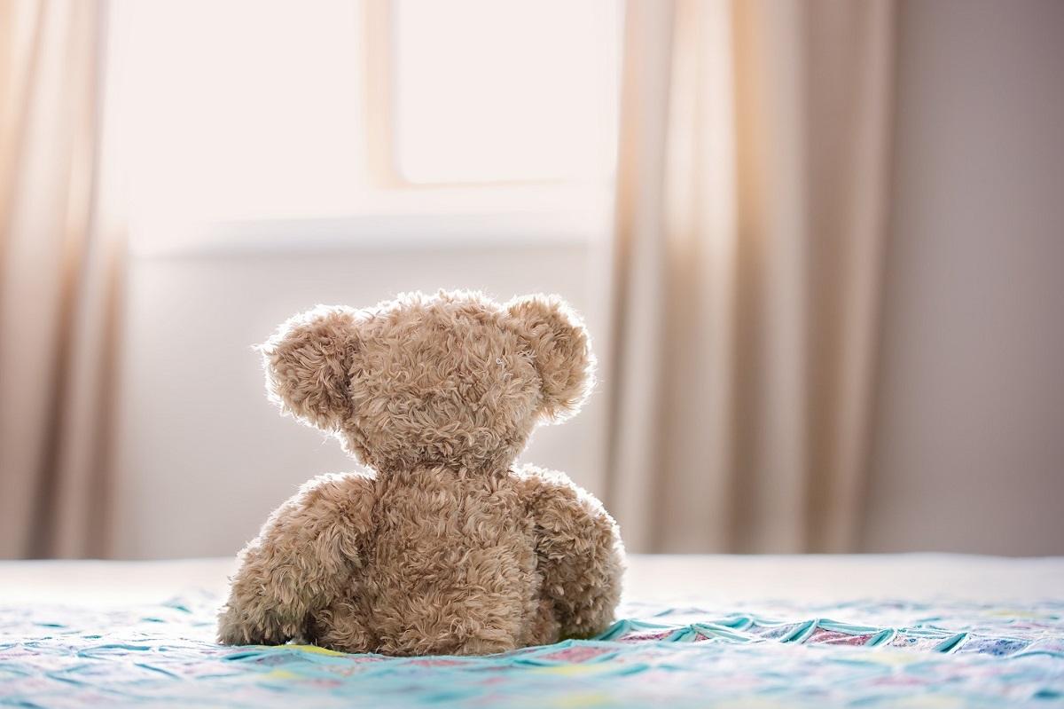 kids teddy bear on bed