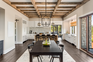 An open floor plan connecting dining room to kitchen in custom home.